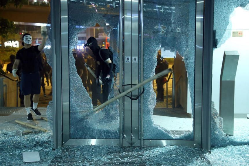 Protesters smash windows in Hong Kong's Wong Tai Sin district on Oct 4, 2019.