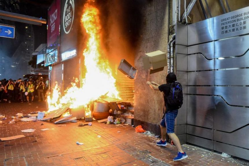 Protesters burn items at the Causeway Bay MTR station exit in Hong Kong on Oct 4, 2019.