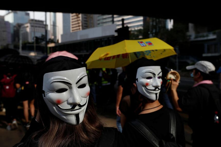 Protesters marching in Hong Kong's Central district on Oct 5, 2019.