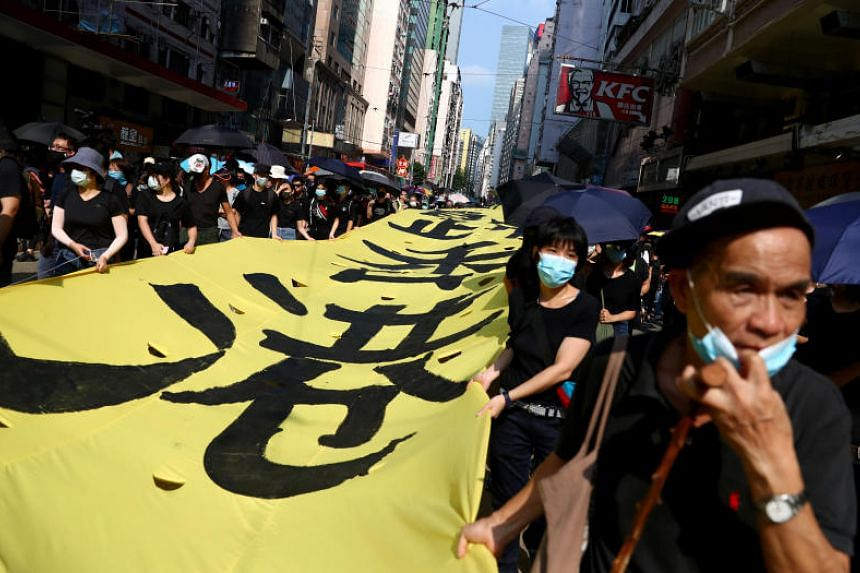 Protesters marching in Hong Kong's Wan Chai district on Oct 5, 2019.