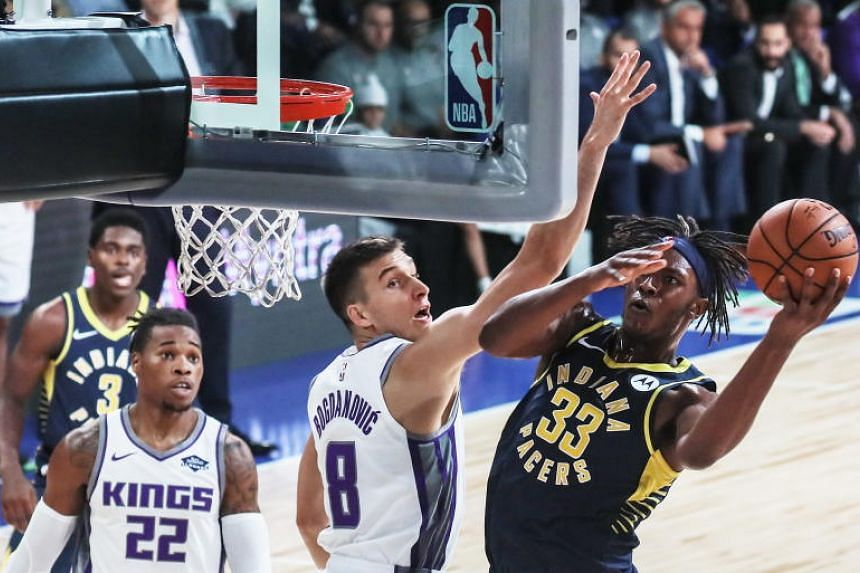 The Indiana Pacers' Myles Turner attempts a shot during their first pre-season NBA game against the Sacramento Kings at the NSCI Dome in Mumbai on Oct 4, 2019.