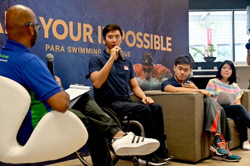 (From right) Ferin Fu, parent of para swimmer Nicole Fu (not in photo), with para-swimmers Wong Zhi Wei and Toh Wei Soong on the sidelines of Toyota's Start Your Impossible initiative at the Singapore Sports Hub.