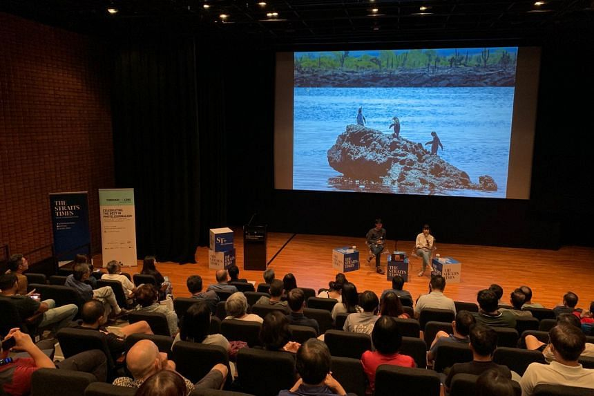 The Straits Times' executive photojournalist Mark Cheong and environmental correspondent Audrey Tan giving a talk on climate change at the National Museum Singapore on Oct 5, as part of ST's series of talks on photojournalism.