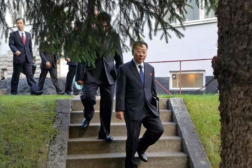 A handout photo shows North Korean delegates, including top negotiator Kim Myong Gil, leaving the North Korean embassy in Stockholm, Oct 5, 2019, to attend a meeting with US officials to prepare for formal working-level nuclear talks.