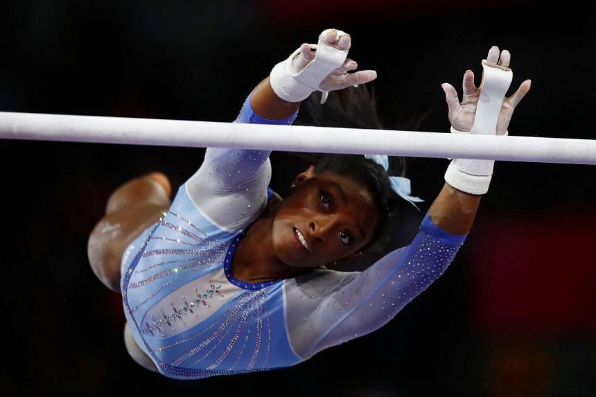 Biles in action during a warm-up.