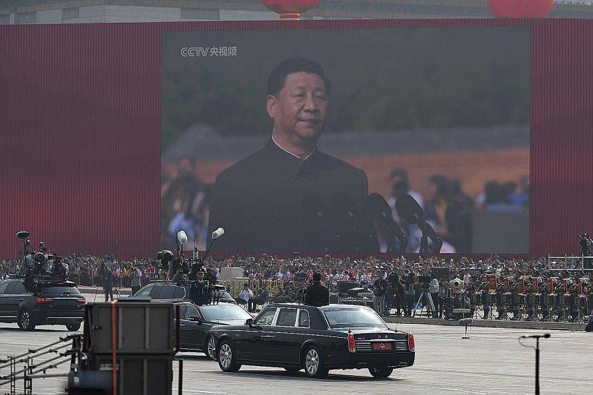Chinese President Xi Jinping beginning his review of troops from a car during a military parade at Tiananmen Square in Beijing on Tuesday to mark the 70th anniversary of the founding of the People's Republic of China.