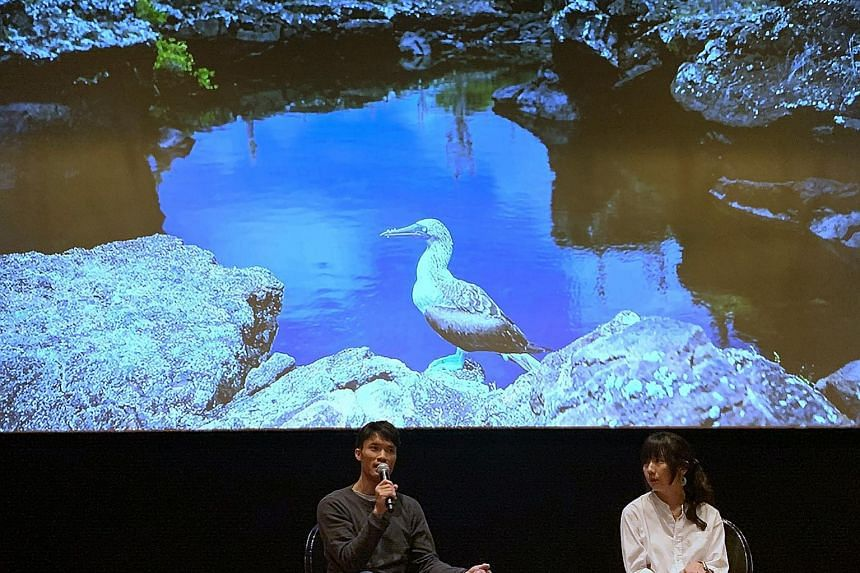 ST executive photojournalist Mark Cheong and environment correspondent Audrey Tan giving a talk yesterday on a climate change special published on June 9.