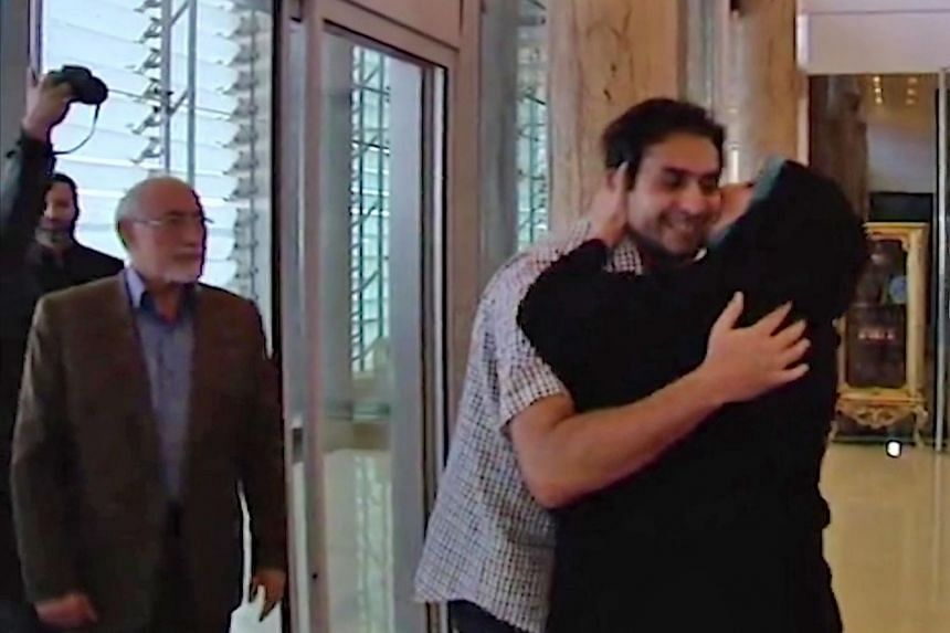 An image grab from footage released by Iranian IRIB TV channel on Oct 5, 2019 shows what it said was Dehbashi Kivi, a PhD student at the University of Queensland in Brisbane, arriving at Teheran's Imam Khomeini International Airport from Australia fo