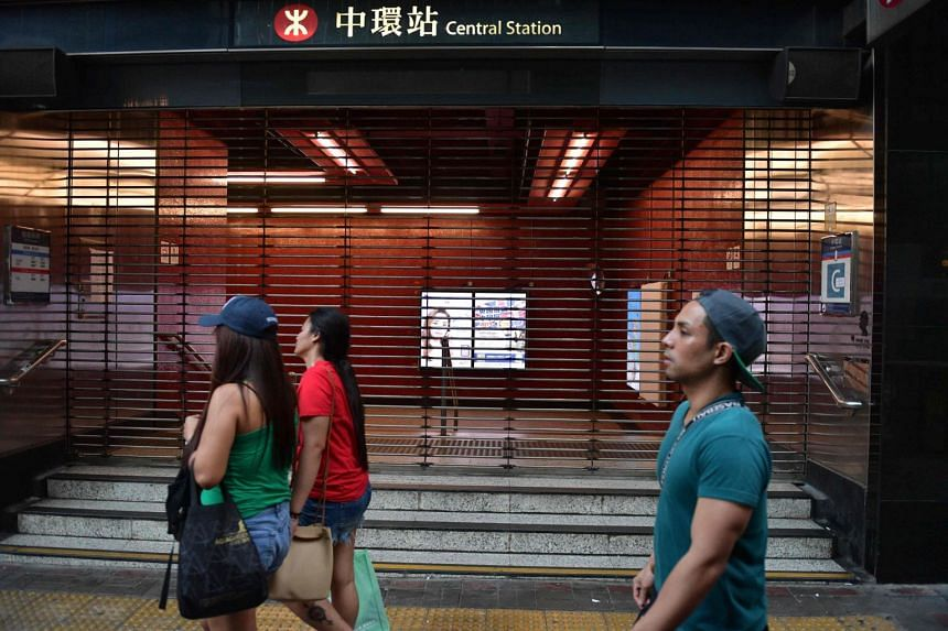 Pedestrians walk past the shuttered underground MTR rail station in the Central district in Hong Kong on Oct 5, 2019. Hong Kong's rail operator MTR Corp said that due to serious vandalism, some stations will not be opened for service on Sunday.
