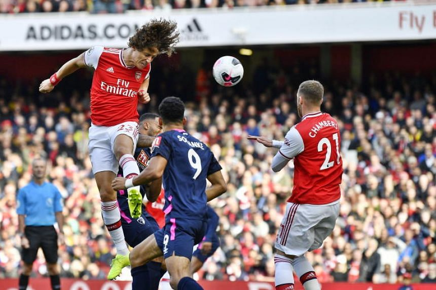 Arsenal player David Luiz (left) scores the opening goal during the English Premier League game between Arsenal and Bournemouth in London on Oct 06, 2019.