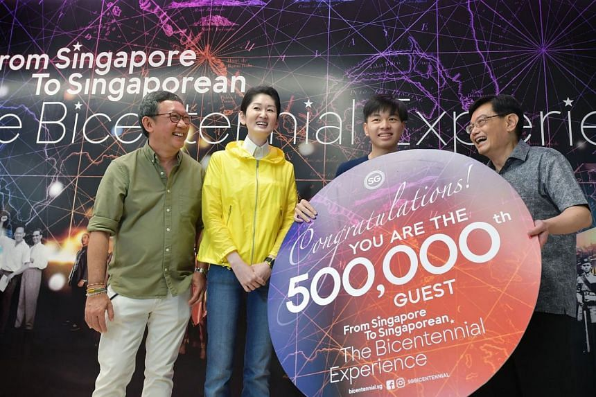 The exhibition's 500,000th visitor, student Tit Yee Kiat, 18 (second from right) being welcomed by (from left) Bicentennial Experience creative director Michael Chiang, Singapore Bicentennial Office executive director Gene Tan, and DPM Heng Swee Keat
