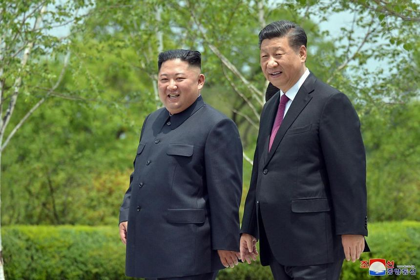 Mr Xi Jinping (right) was the first Chinese leader to visit the reclusive North Korea in 14 years when he made a highly symbolic trip to the nuclear-armed state in June.