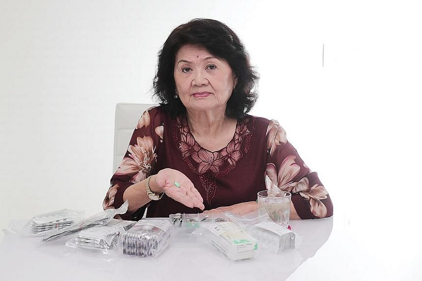 Madam Tan Choon Lan, 81, with the medication and supplements that she takes every day. She is among the many seniors in Singapore who find it difficult to understand prescription medication labels.