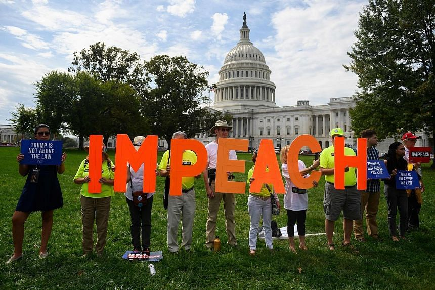 "Protesters taking a stand against President Donald Trump in front of the US Capitol building during a ""People's Rally for Impeachment"" late last month. PHOTO: AGENCE FRANCE-PRESSE"