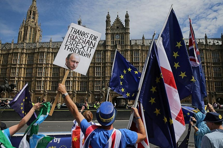 A demonstrator with a placard bearing an image of Russia's President Vladimir Putin at an anti-Brexit protest in London. With polls looming in Britain, the authorities are gearing up to tackle foreign meddling. PHOTO: AGENCE FRANCE-PRESSE