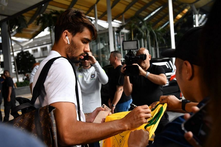 Brazil player Lucas Paqueta signing autographs for fans after arriving at JW Marriott Singapore South Beach.