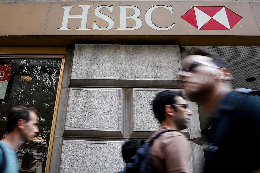 HSBC's cost-cutting drive comes as global banks lay off staff, with the industry facing low or negative interest rates and weak investment banking revenues. PHOTO: REUTERS