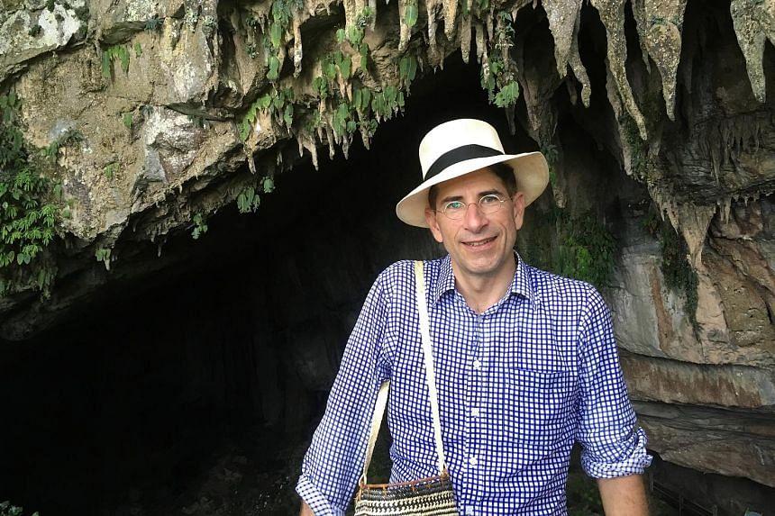 NUS science historian John van Wyhe at a cave in Sarawak.