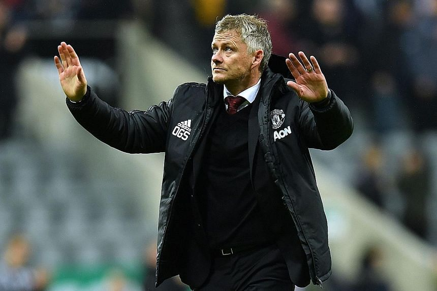 A calm Manchester United manager Ole Gunnar Solskjaer acknowledging the fans after the 1-0 loss to Newcastle at St James' Park on Sunday. It was their third loss of the season, which left them in 12th place and two points above the relegation zone.