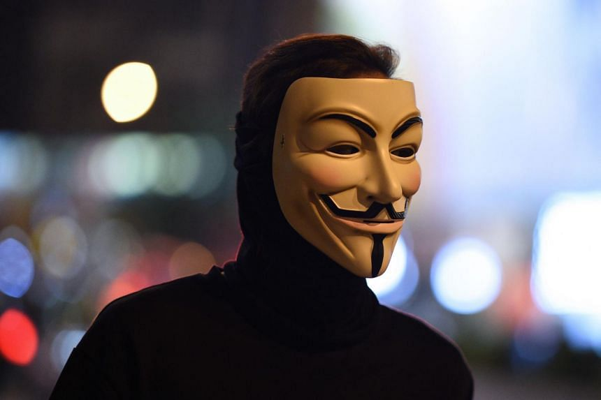 A protester wearing a Guy Fawkes mask during a stand-off with police near the Mongkok police station in Hong Kong on Oct 7, 2019.