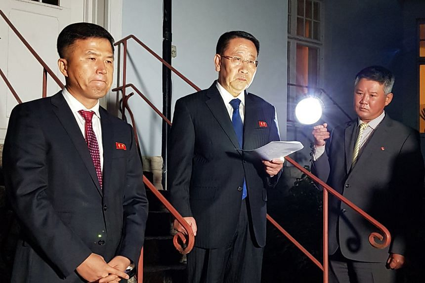 North Korea's top nuclear negotiator Kim Myong Gil (centre) reading a statement in front of the country's embassy in Stockholm after a meeting with US officials for formal working-level nuclear talks.