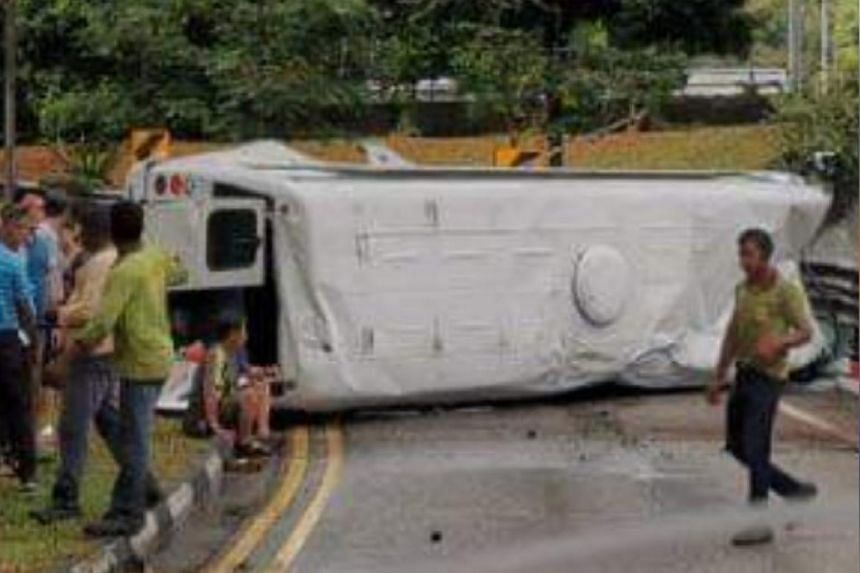 Photos on the Singapore Road Accident Facebook page show the minibus lying on its side across the entire width of the slip road.