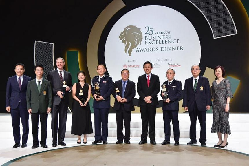 Ministry for Trade and Industry Chan Chun Sing with award recipients at the 25th Business Excellence Awards ceremony on Oct 8, 2019.