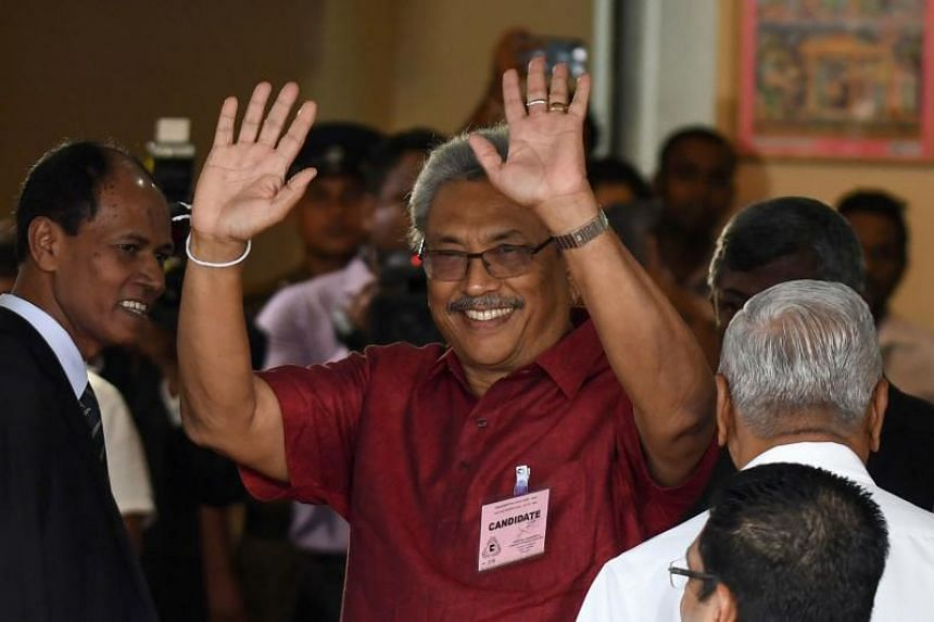 Former Sri Lankan president Mahinda Rajapakse's younger brother Gotabhaya waves to supporters in Colombo on Oct 7, 2019, after filing his nomination papers to contest in the upcoming presidential election.