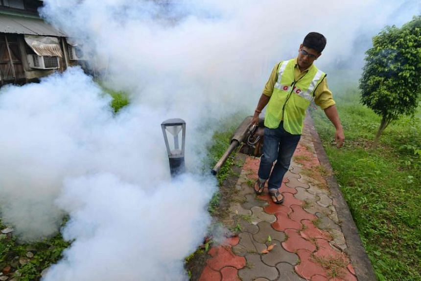 A worker fumigates to combat dengue and malaria, at a residential area in Guwahati, India, on Sept 24, 2019. Singapore itself was officially registered as malaria-free in 1982.