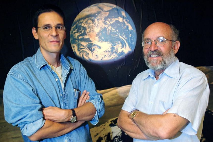 Swiss astronomers Didier Queloz (left) and Michel Mayor at the Astronomical Observatory of the University of Geneva in Versoix, Switzerland on Aug 11, 2005. They share half the 2019 Nobel Prize for Physics, while Dr James Peebles was awarded the othe
