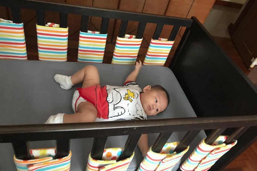 Ms Chua Jia Ying decided to replace the cloth cot bumpers on her five-month-old baby's cot with individual bumper wraps for each of its slats. This lowers the risk of the baby accidentally pressing its face against the bumpers and suffocating.