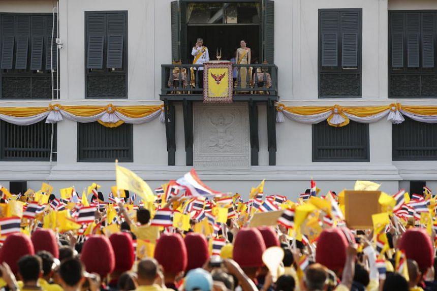 A photo taken on May 6 shows Thai King Maha Vajiralongkorn Bodindradebayavarangkun and Queen Suthida greeting well-wishers as part of the monarch's the royal coronation ceremony in Bangkok.