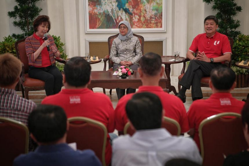 President Halimah Yacob flanked by NTUC president Mary Liew and NTUC secretary-general Ng Chee Meng during a dialogue and tea reception with union leaders at the Istana on Oct 8, 2019.