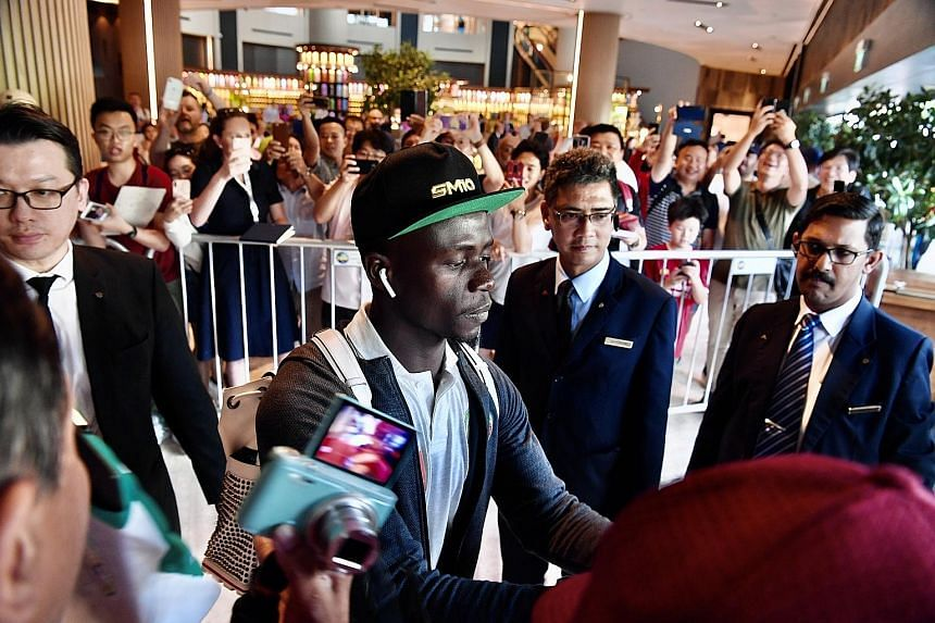 Sadio Mane signing autographs for his supporters, who thronged the lobby of Swissotel The Stamford for the arrival of the Liverpool forward, as well as the Senegal team.