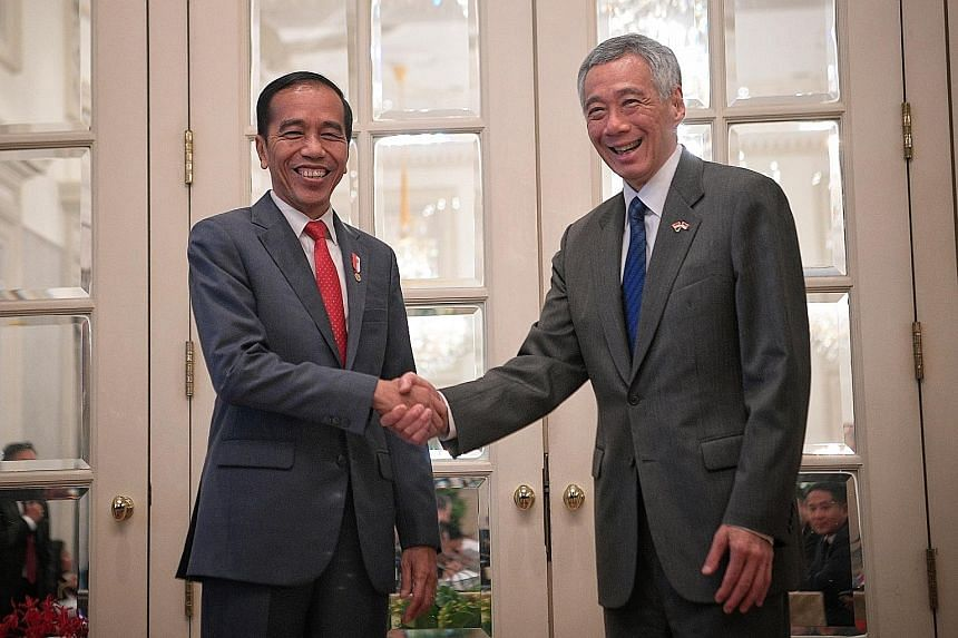 At yesterday's meeting between the two countries' delegations were (from left) Indonesia's Coordinating Minister for Maritime Affairs Luhut Pandjaitan, Coordinating Minister for Economic Affairs Darmin Nasution, President Joko Widodo, Foreign Ministe