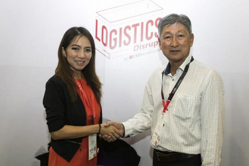 (From left) Tan Su Shan, DBS group head of institutional banking, and Yang Kee Logistics' chairman and founder Koh Yang Kee at DBS' Logistics Disrupt event. Yang Kee Logistics is the first to sign up for DBS' digital logistics solutions package