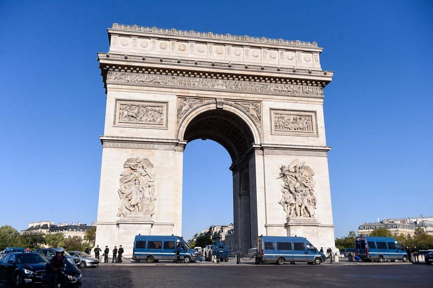 The 30-year-old victim was approached outside the five-star Hotel Napoleon near the Arc de Triomphe by a man who asked for a cigarette.