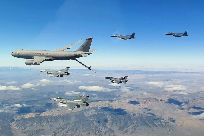 RSAF's Multi-Role Tanker Transport (left) positioning itself to refuel aircraft in mid-air.