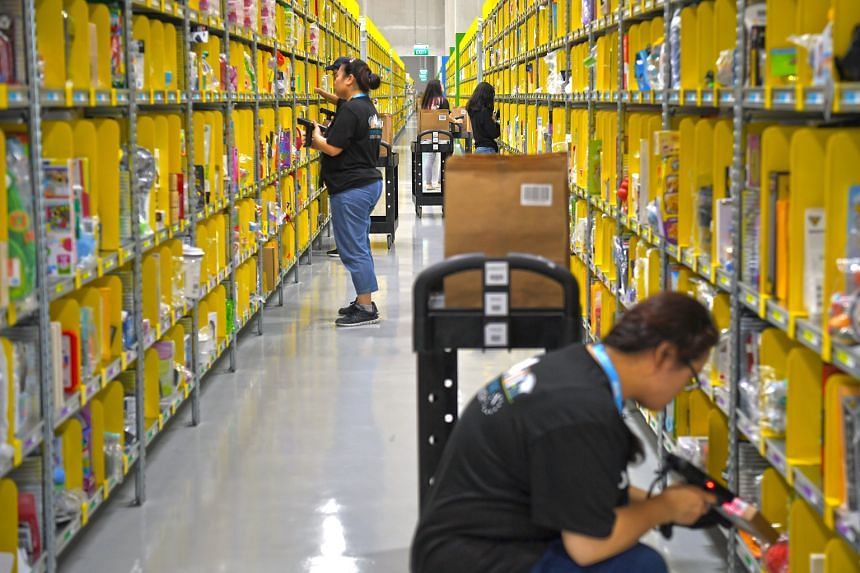 Amazon's Prime Now facility in Singapore. Amazon's entry into the market here will see it go head-on against rivals such as Lazada and Shopee.
