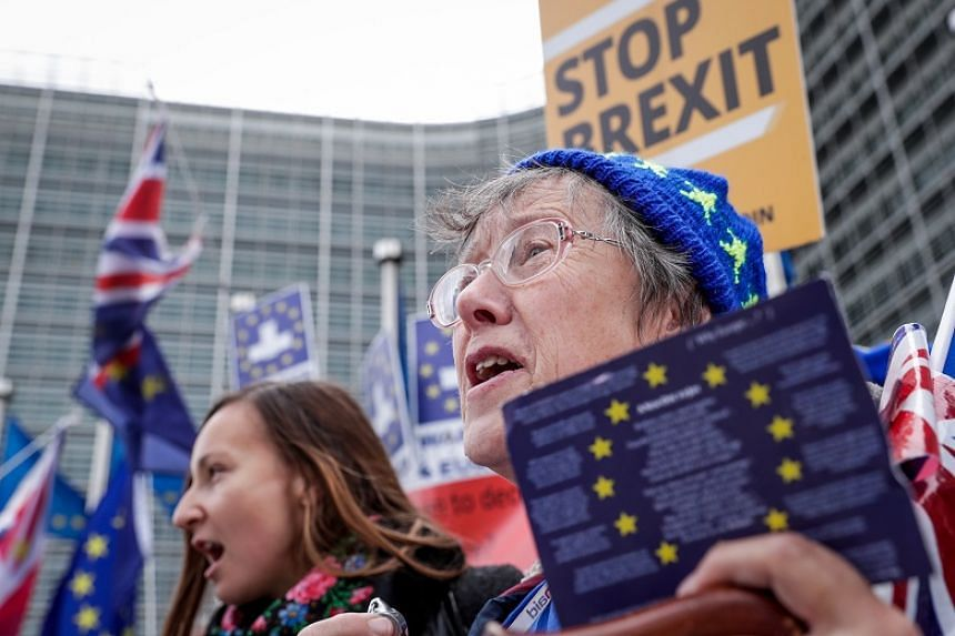 Anti-Brexit demonstrators stand in front of the European Commission in Brussels, Belgium, on Sept 9, 2019.