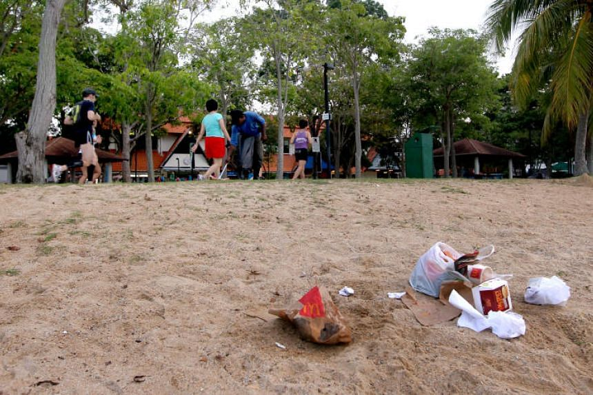 Litter left behind at the beach at East Coast Park.