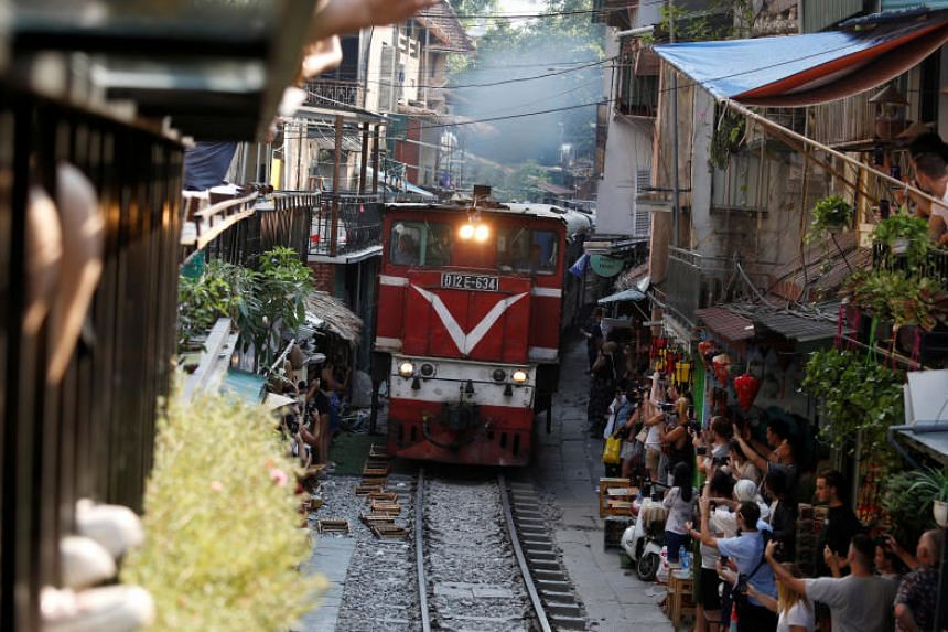 Built in 1902 under French colonial rulers, the railway to Vietnam's northern provinces brushes the rear of houses and shops as it snakes through Hanoi's dense centre.