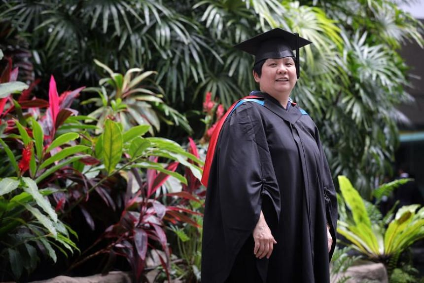 Ms Jean Ang, who is in her early 50s, graduated from the Singapore University of Social Sciences with a bachelor's degree with honours in business on Oct 9, 2019.