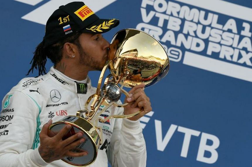 Lewis Hamilton celebrates on podium after winning the Formula One Russian Grand Prix in Sochi on Sept 29, 2019.