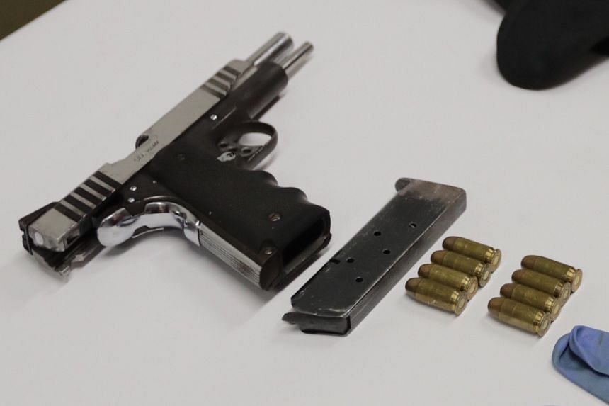 The pistol, which was loaded with four bullets, was found along with four spare bullets.