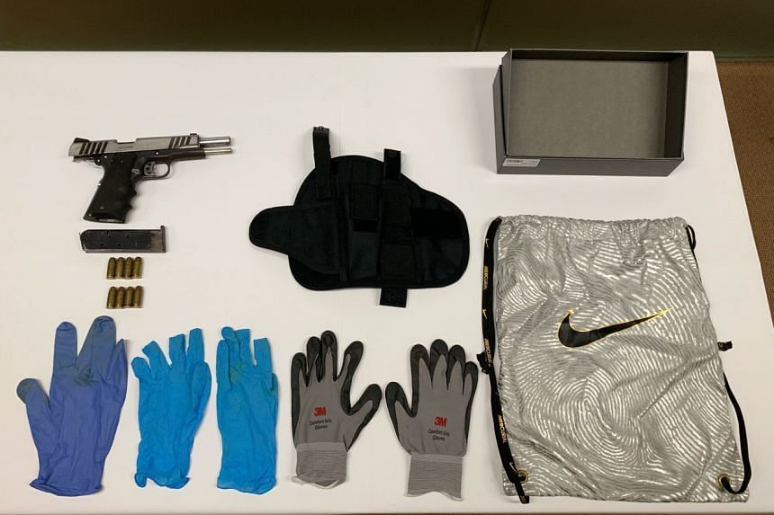 Evidence on display during the CNB and police press conference. Officers found a loaded firearm during a CNB and police raid on Oct 8 and 9, 2019.