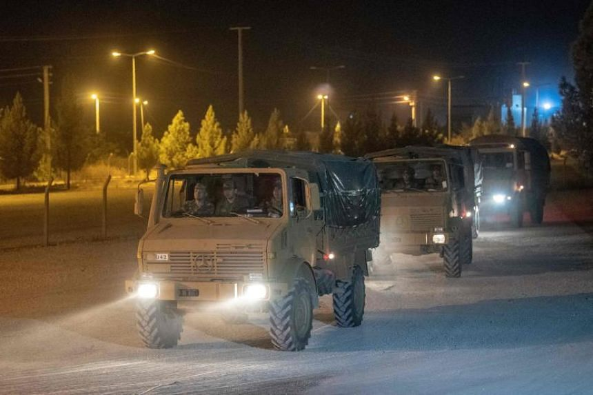 Turkish army soldiers drive towards the border with Syria near Akcakale in Sanliurfa province, on Oct 8, 2019.