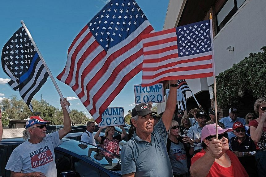 Supporters of US President Donald Trump taking part in a rally in Tucson, Arizona, on Tuesday against the impeachment inquiry. The White House said it would refuse to cooperate with the inquiry, and that Mr Trump had been denied basic due process rig