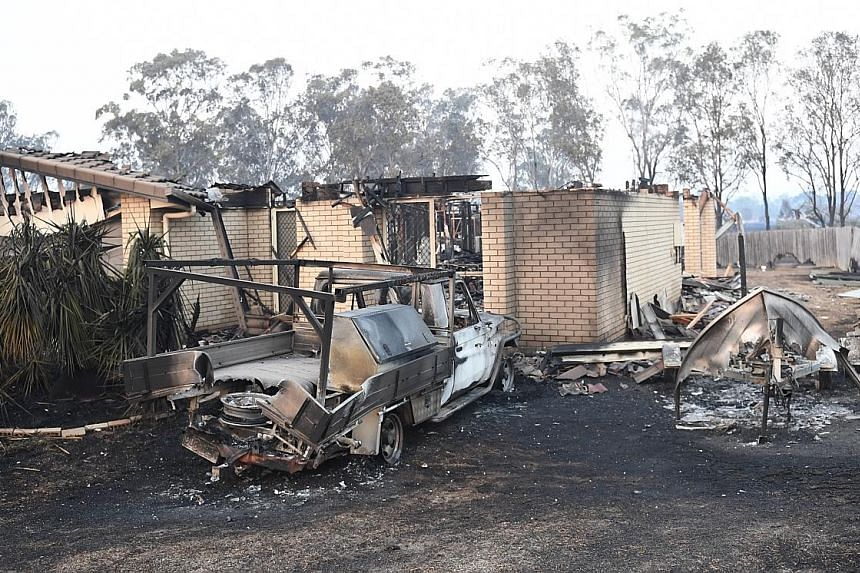 As many as 30 houses were destroyed in the fire in New South Wales which the police are treating as suspicious.