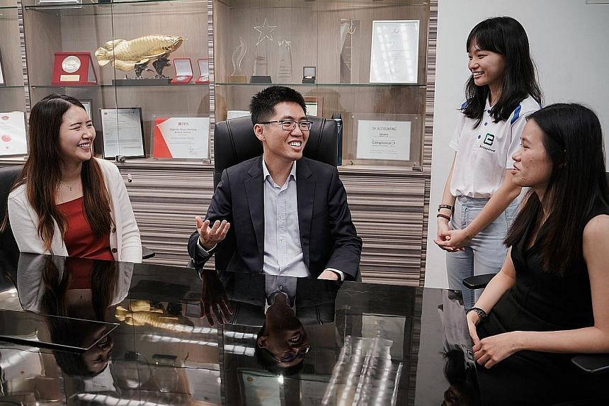 Mr Lawrence Chai, founder and director of 3E Accounting, with (from left) the firm's consultant Dorothy Soh, digital marketing executive Sng Qi Wen and human resources executive Ho Li Fui. The firm became unionised last month and is sponsoring NTUC m